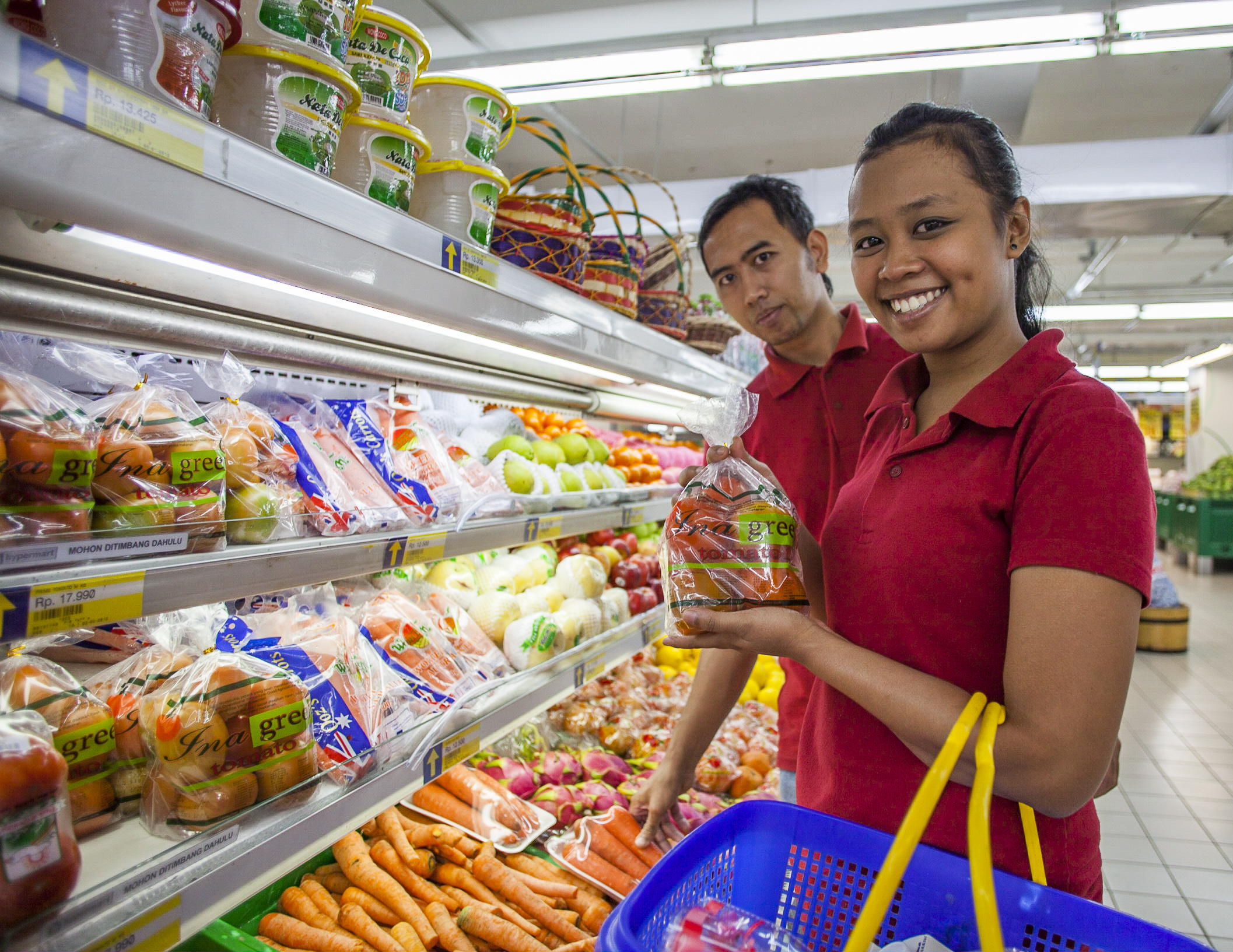 Consumers buying vegetables in supermarket